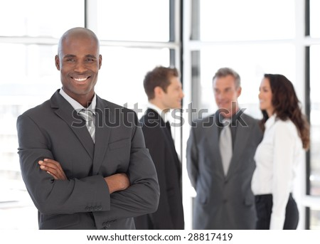 Young african-america Businessman in Front of Team - stock photo