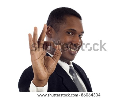 Young African American business man showing the okay sign over white background - stock photo