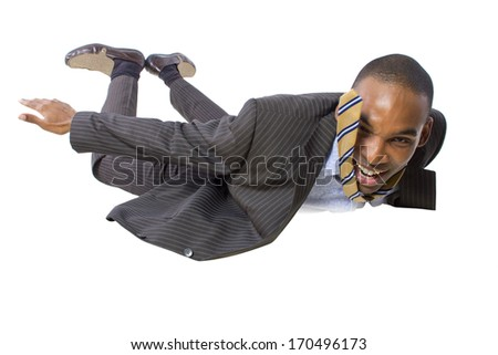 young african american businessman flying or skydiving  - stock photo