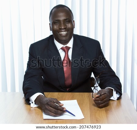 Young african american businessman in the office - stock photo