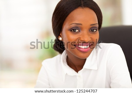 young african american businesswoman closeup portrait in office - stock photo