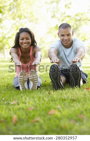 Young African American Couple Exercising In Park - stock photo