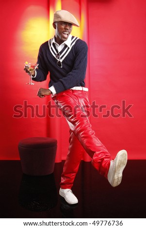 Young african american having a cocktail at the lounge - stock photo