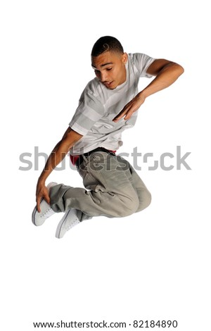 Young African American hip hop dancer jumping isolated over white background - stock photo