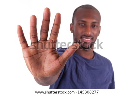 Young African American man his hands palm, isolated on white background - stock photo
