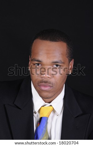 young African American man in a hat and suit - stock photo