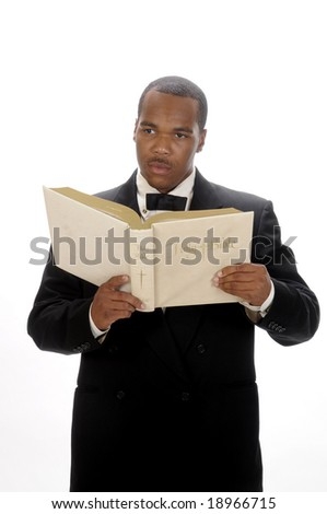 young African American preacher giving sermon, quoting from the bible - stock photo