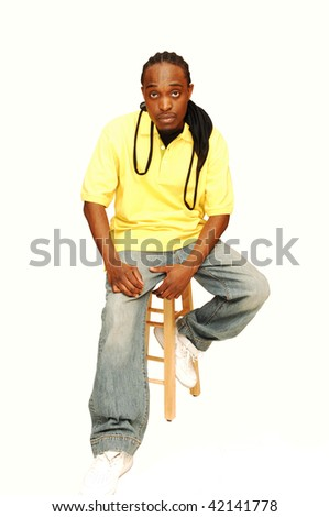 Young African American sitting on an bar chair in the studio for white background. - stock photo