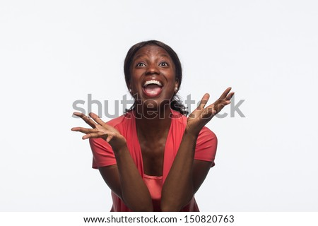 Young African American woman excited, horizontal - stock photo