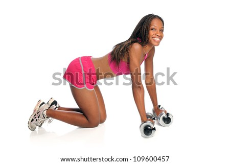 Young African American woman exercising with dumbbells on floor isolated over white background - stock photo