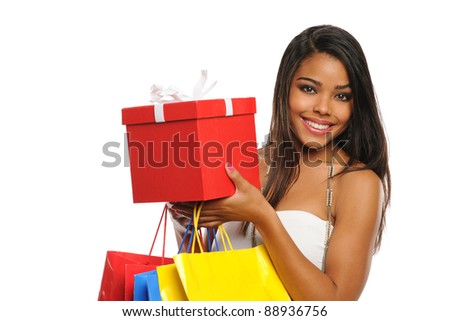 Young African American woman holding a present and shopping bags isolated on white background - stock photo