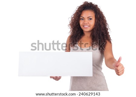 Young African American woman holding blank sign isolated - stock photo