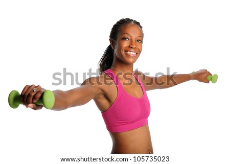 Young African American woman lifting dumbbells isolated over white background - stock photo