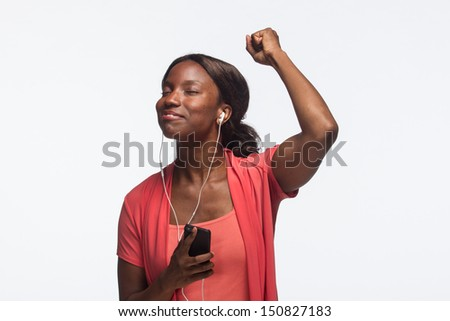 Young African American woman listening to iPod, horizontal - stock photo