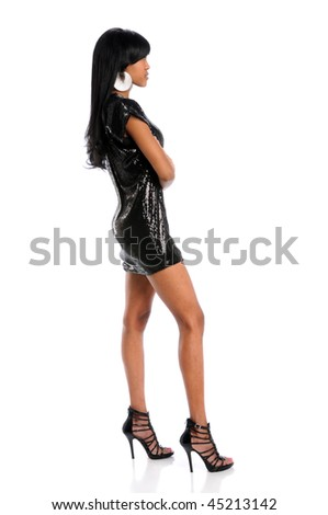 Young African American woman posing with arms crossed - stock photo