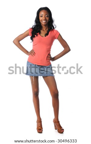 Young African American woman standing with hands on hips - stock photo