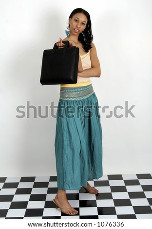 Young African American woman standing with portfolio in her hand - stock photo