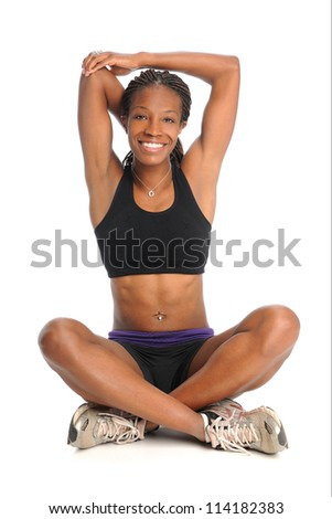 Young African American woman stretching isolated over white background - stock photo