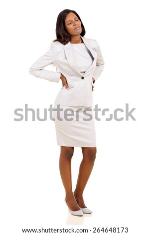 young african businesswoman having back pain isolated on white background - stock photo