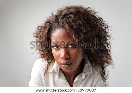 Young african businesswoman with angry expression - stock photo