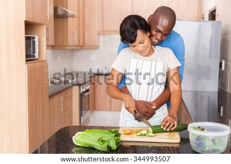 young african couple cooking in kitchen - stock photo