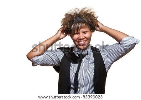 Young African girl is cleaning up her looks in front of a white background. - stock photo