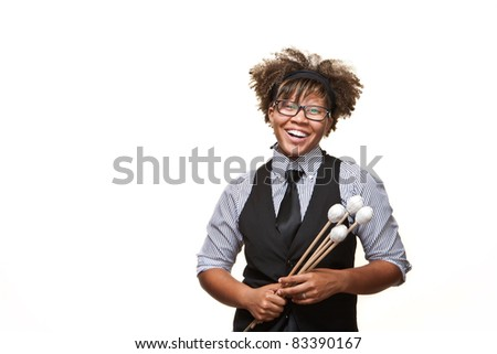 Young African Musician with glasses poses laughing in front of a white background in the studio. - stock photo