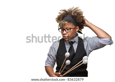Young African musician with glasses poses thoughtfully against a white background in the studio. - stock photo
