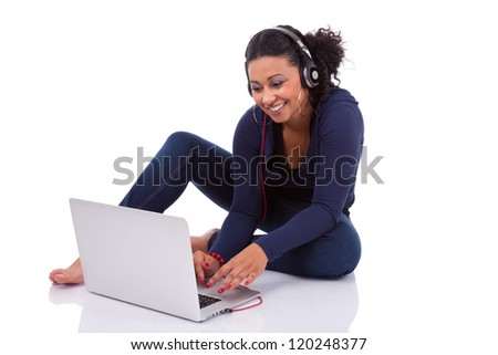 Young African student girl using a computer, isolated on white background - stock photo