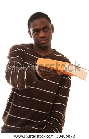 young african student giving you the book (selective focus) - stock photo