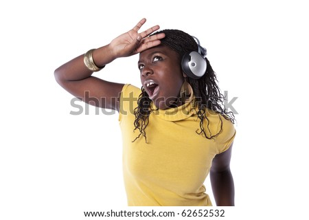young african woman listening and dancing with headphones (isolated on white) - stock photo