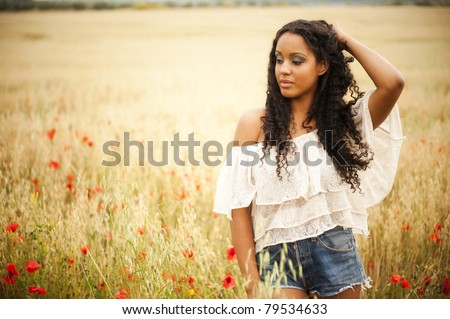 Young african woman outdoors - stock photo