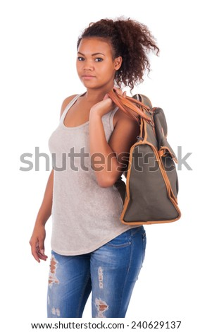 Young African woman travelling with her bag - isolated - stock photo