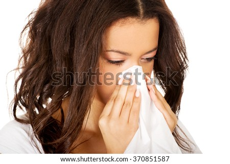 Young african woman using a tissue. - stock photo