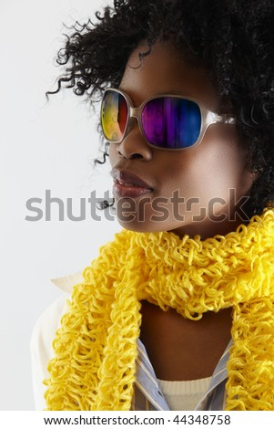 young African woman with fun disco sunglasses. - stock photo