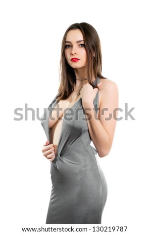 Young alluring lady wearing sexy grey dress. Isolated on white - stock photo