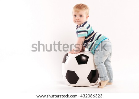 young amateur football plays with a ball - stock photo