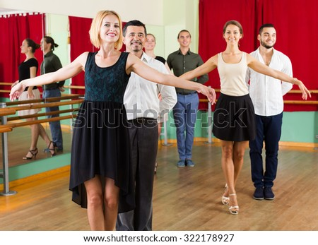 young american group of people have fun while dancing waltz - stock photo