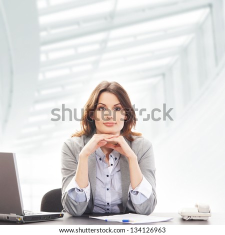 Young and attractive business woman working  in office - stock photo