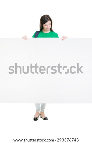 Young and attractive teenage schoolgirl isolated on white  - stock photo