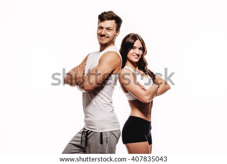 Young and beautiful athletic woman and man on white background - stock photo
