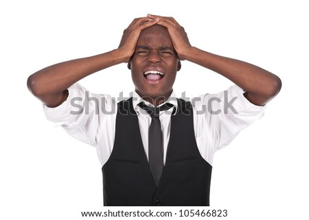 young and beautiful black man screaming with headache - stock photo