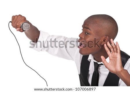 young and beautiful black man singing with his hand behind the ear - stock photo