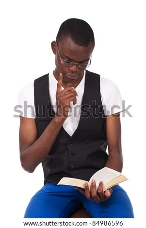 young and beautiful black man sitting and reading  book - stock photo