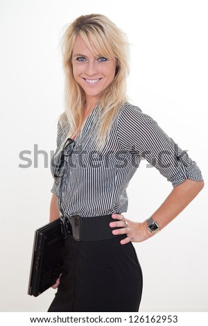 Young and beautiful blond caucasian businesswoman in her twenties - stock photo