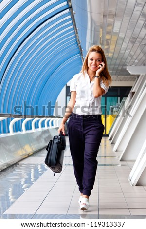 Young and beautiful business woman on the phone - stock photo