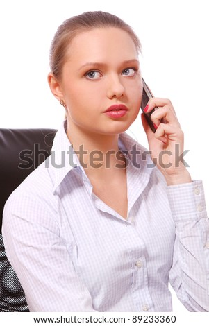 Young and beautiful business woman talking by phone - stock photo
