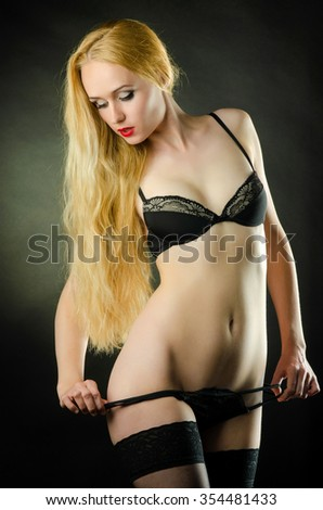Young and beautiful cabaret dancer in sexy vintage lingerie - stock photo