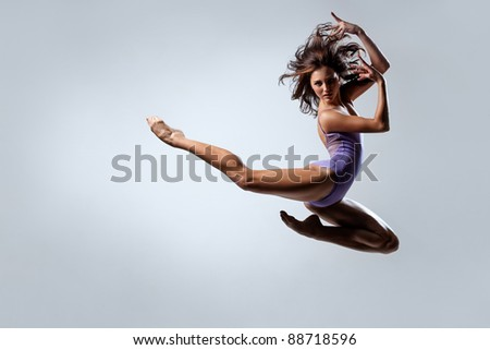 young and beautiful dancer posing on studio background - stock photo