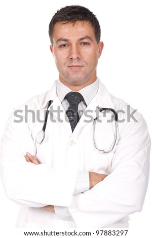young and beautiful doctor standing  with arms crossed - stock photo